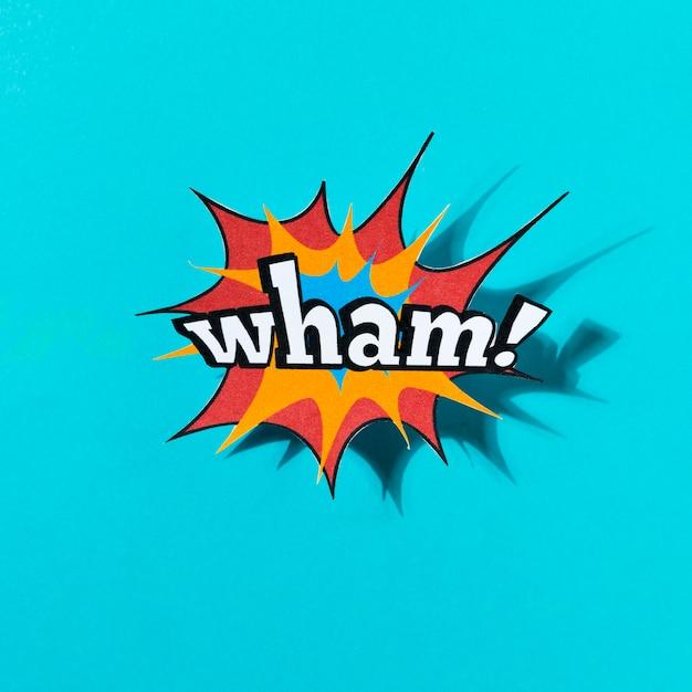 Wham efeito de quadrinhos palavra sobre fundo azul Foto gratuita