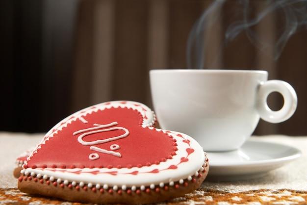 Xícara de café com biscoitos Foto gratuita