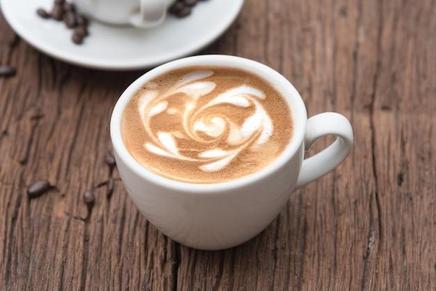 Xícara de café e feijão Foto Premium