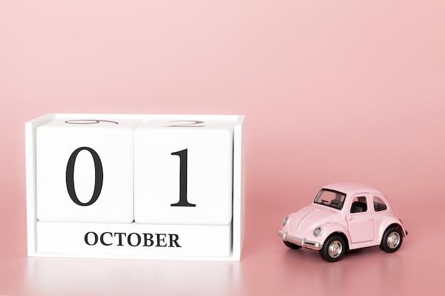01. oktober tag 1 des monats. kalenderwürfel mit auto Premium Fotos