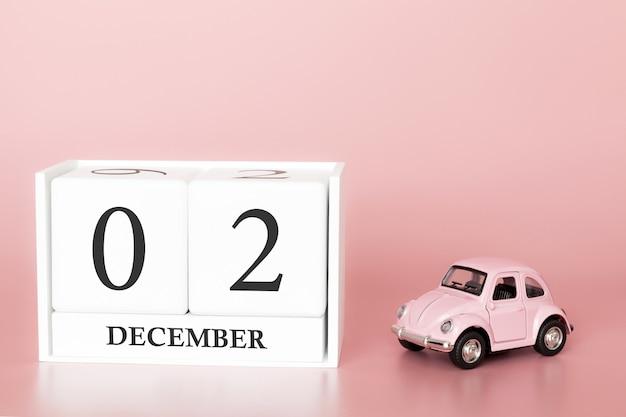 02. dezember tag 2 des monats. kalenderwürfel mit auto Premium Fotos