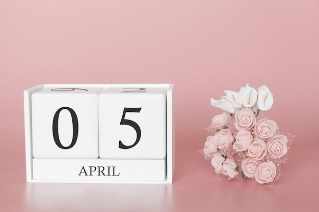05. april. tag 5 des monats. kalenderwürfel auf modernem rosa Premium Fotos