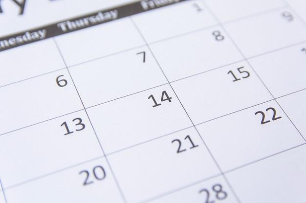14. zahlen auf kalenderseite hautnah hintergrund Premium Fotos