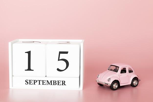15. september. tag 15 des monats. kalenderwürfel mit auto Premium Fotos