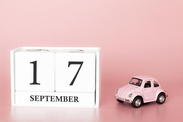 17. september. tag 17 des monats. kalenderwürfel mit auto Premium Fotos