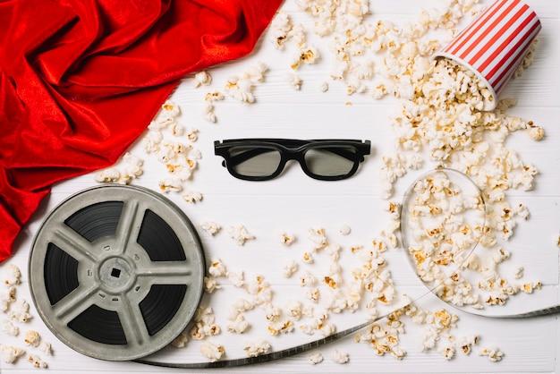 3d-brille und popcorn mit spule Kostenlose Fotos
