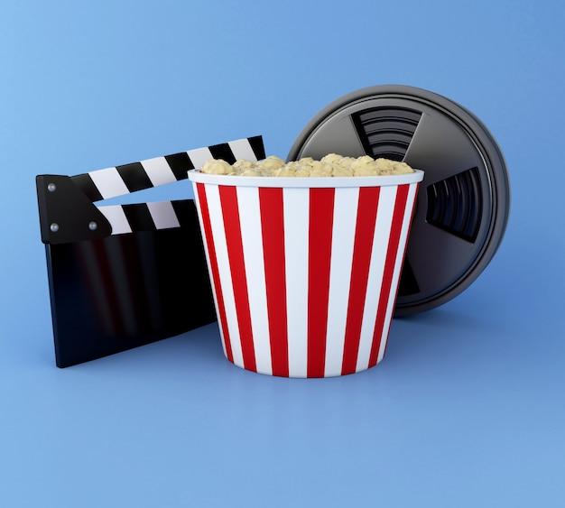 3d darstellung. cinema clapper board, filmrolle und popcorn. kinematographie-konzept. Premium Fotos