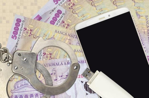 50000 rumänische leu-rechnungen und smartphone mit polizeihandschellen Premium Fotos