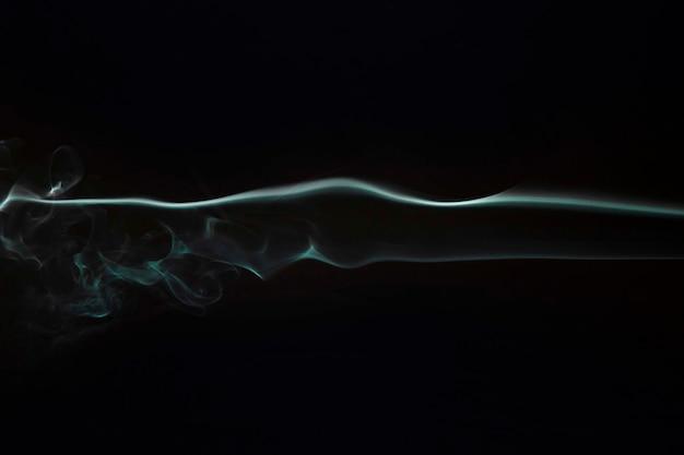 Abgetönter rauch gemasert auf schwarzem hintergrund Kostenlose Fotos