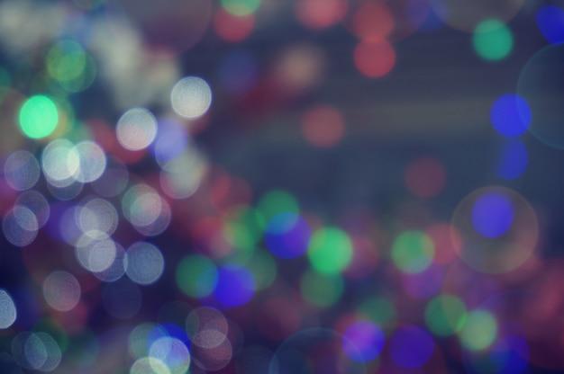 Abstrakt bokeh glitzer vintage lichter. weihnachten bokeh licht defokussiert abstrakten background.can verwendet werden wallpaper textur mit kopie raum bereich für einen text Premium Fotos