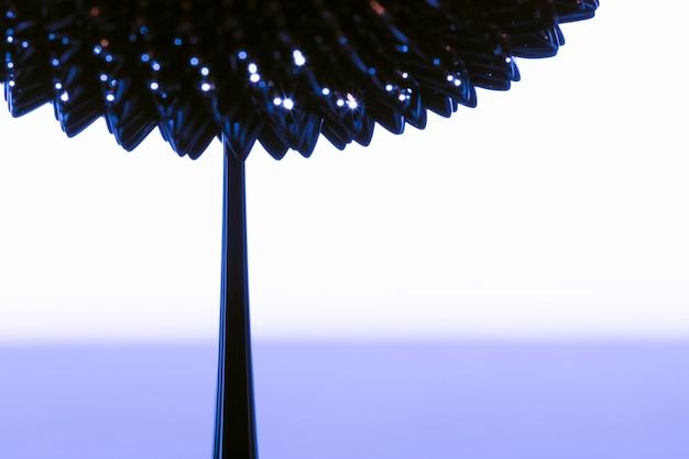 Abstrakte blume des ferromagnetischen flüssigen metalls mit kopienraum Kostenlose Fotos