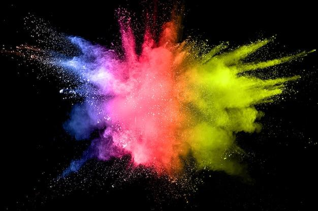 Abstrakte mehrfarbige pulver staubexplosion. Premium Fotos