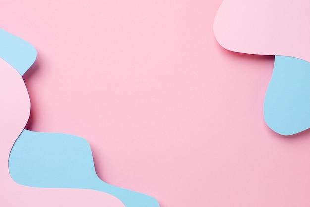 Abstrakte papierschnitt rosa und blaue wellenkunst Premium Fotos