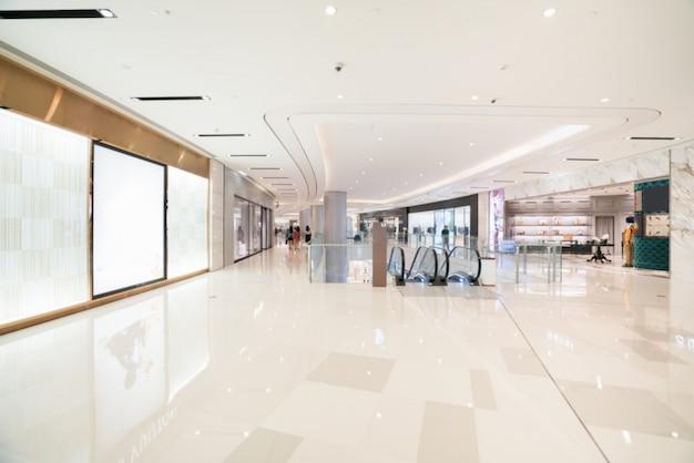 Abstrakte unschärfe und defocused einkaufszentrum im kaufhausinnenraum für hintergrund Premium Fotos