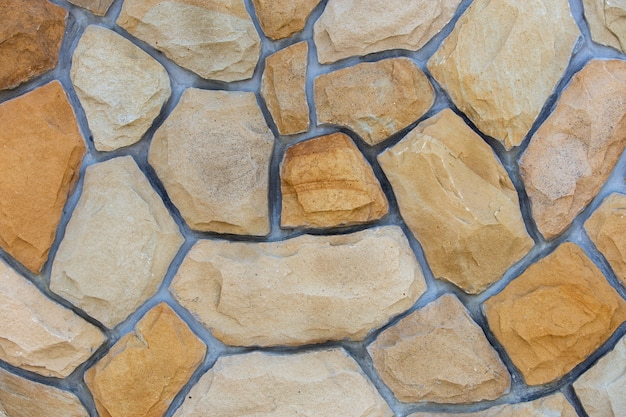 Abstrakte wandoberfläche aus sandsteinen für den einsatz als. Premium Fotos
