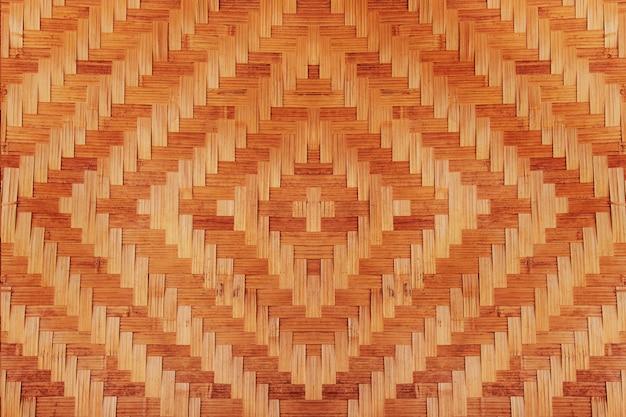 Abstrakter bambus gesponnene musterbeschaffenheit für hintergrund. detail der wand des landhauses aus bambus Premium Fotos