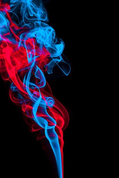 Abstrakter blauer und roter raucheffekthintergrund Premium Fotos