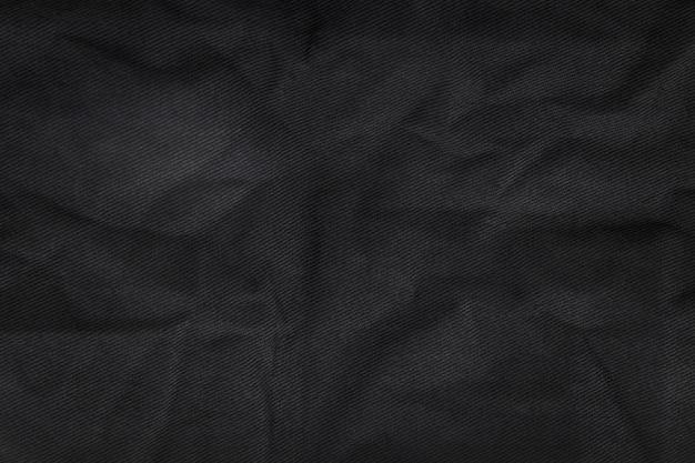 Abstrakter gewebebeschaffenheitshintergrund. zerknittertes canvas-textilmaterial. Premium Fotos