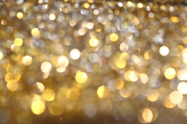 Abstrakter goldener bokeh hintergrund mit glänzenden defocus scheinen Premium Fotos