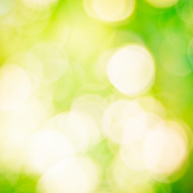 Abstrakter grüner bokeh hintergrund Kostenlose Fotos