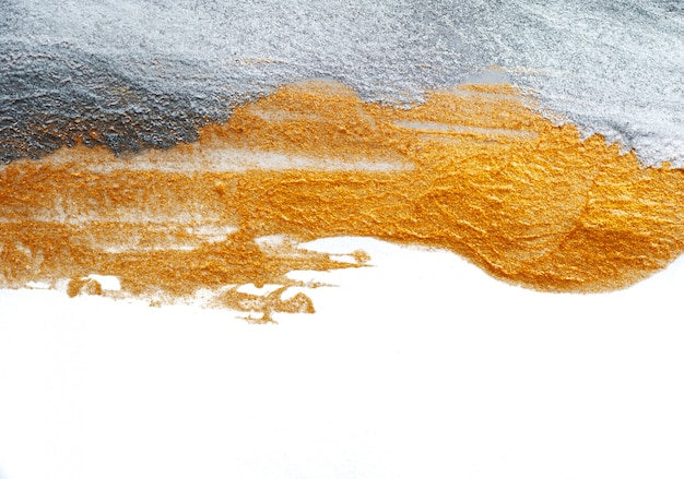 Abstrakter hintergrund gemalt mit einem pinsel der gold- und silberfarbe Premium Fotos
