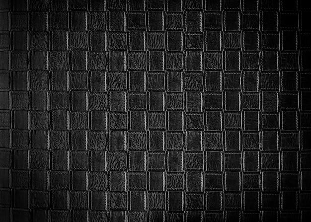 Abstrakter hintergrund vom schwarzen ledernen muster auf sofa. retro und vintage hintergrund. Premium Fotos