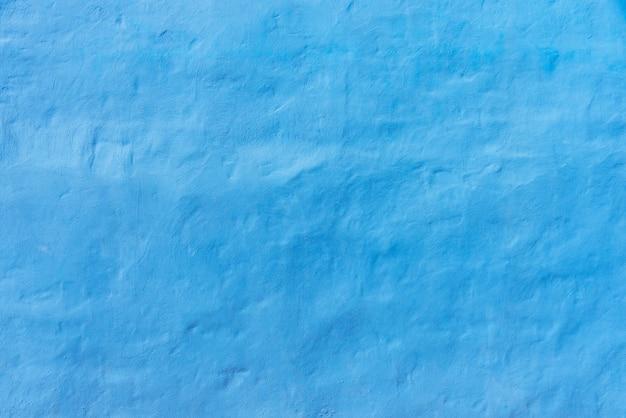 Abstrakter hintergrund von der blauen konkreten beschaffenheitswand. Premium Fotos
