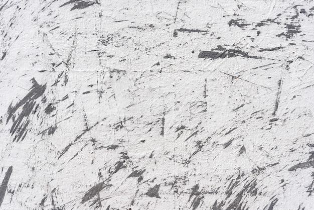 Abstrakter hintergrund von der weißen betonmauer mit grunge und verkratzt. Premium Fotos