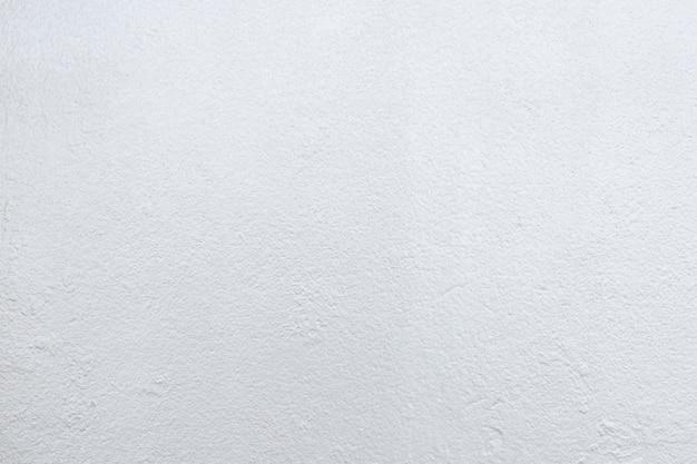 Abstrakter hintergrund von der weißen konkreten beschaffenheit mit licht im hellen ton. Premium Fotos