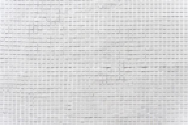 Abstrakter hintergrund von verzierten grauen ziegelsteinmosaikfliesen auf wand. Premium Fotos