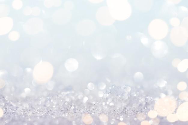 Abstrakter schnee und glitzerhintergrund mit goldlichtern Premium Fotos