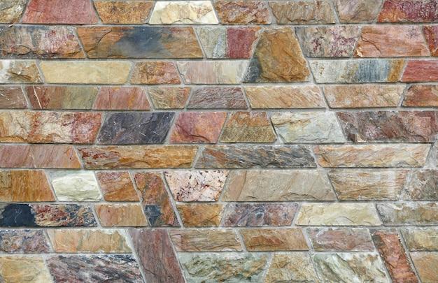 Abstrakter steinfliesenbeschaffenheitsbacksteinmauerhintergrund Premium Fotos