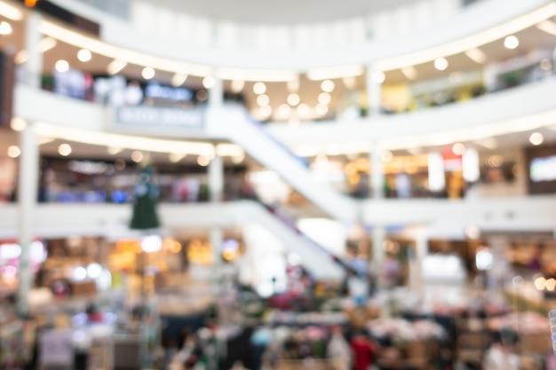 Abstrakter unschärfeeinkaufszentruminnenraum des kaufhauses Kostenlose Fotos