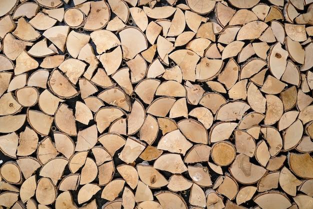 Abstraktes foto eines stapels des natürlichen hölzernen klotzhintergrundes Premium Fotos