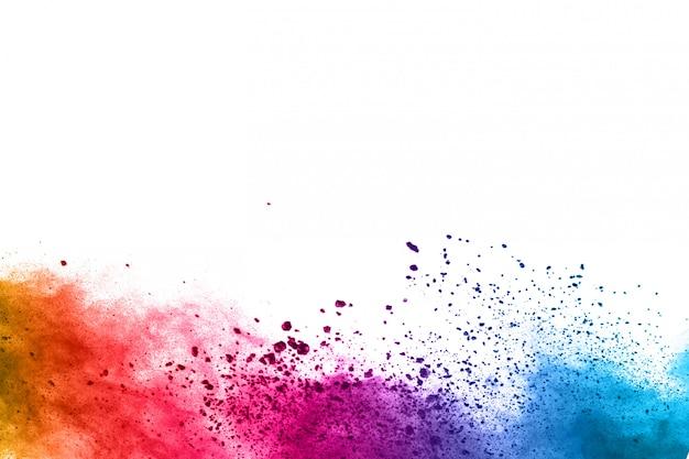 Abstraktes pulver bespritzt hintergrund. bunte pulverexplosion auf weißem hintergrund. Premium Fotos