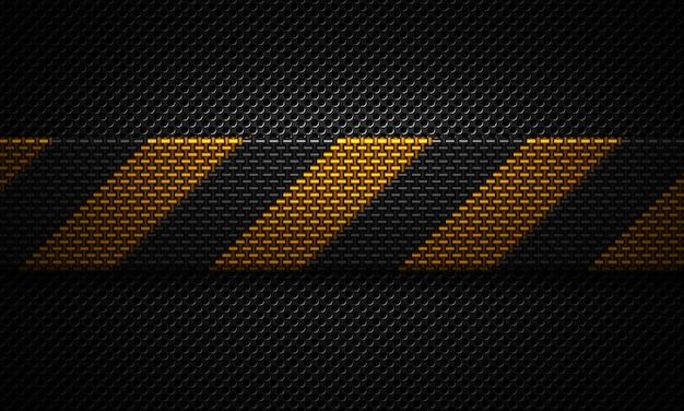 Abstraktes schwarzes materialdesign der perforierten platte mit warnendem band Premium Fotos