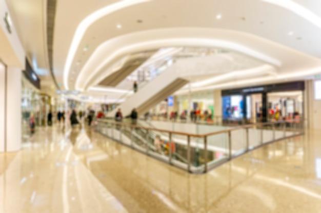 Abstraktes unschärfeeinkaufszentrum des kaufhausinnenraums für hintergrund Premium Fotos