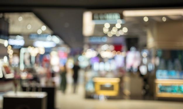 Abstraktes verschwommenes einkaufszentrum für kunden Premium Fotos