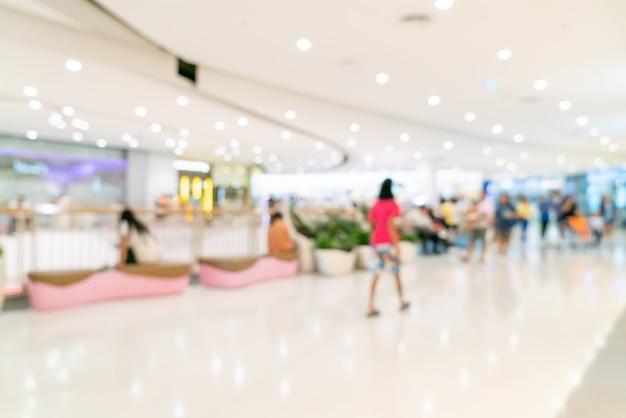Abstraktes verwischendes einkaufszentrum oder kaufhausinnenraum Premium Fotos