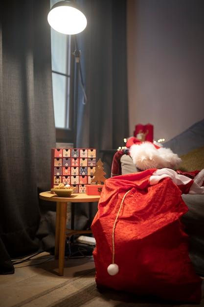 Adventskalender mit weihnachtsmann-sack Kostenlose Fotos