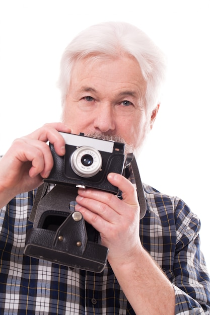 Älterer fotograf mit retro- kamera Kostenlose Fotos
