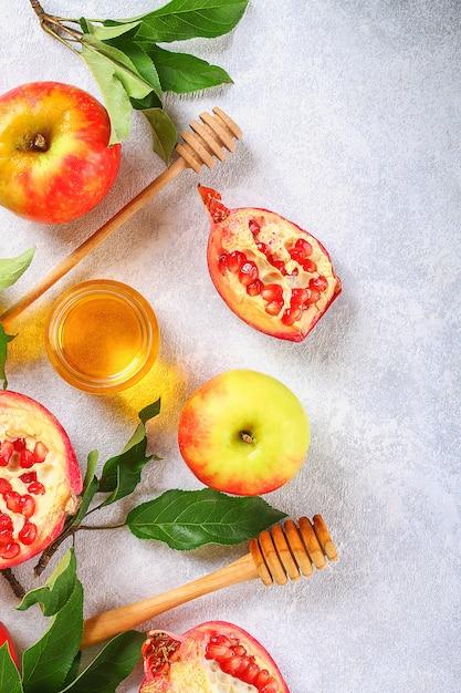 Äpfel, honig, granatapfel Premium Fotos
