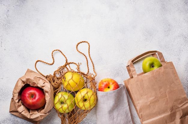 Äpfel in verschiedenen umweltfreundlichen verpackungen Premium Fotos