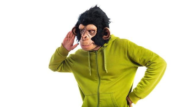 Affe mann hört etwas Kostenlose Fotos