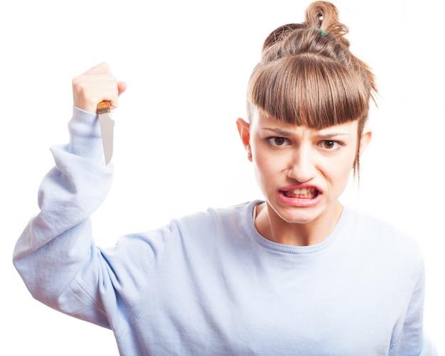 Aggressive jugendliche mit einem messer Kostenlose Fotos