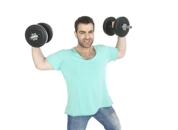 Aktiver mann mit hanteln und jeans Kostenlose Fotos