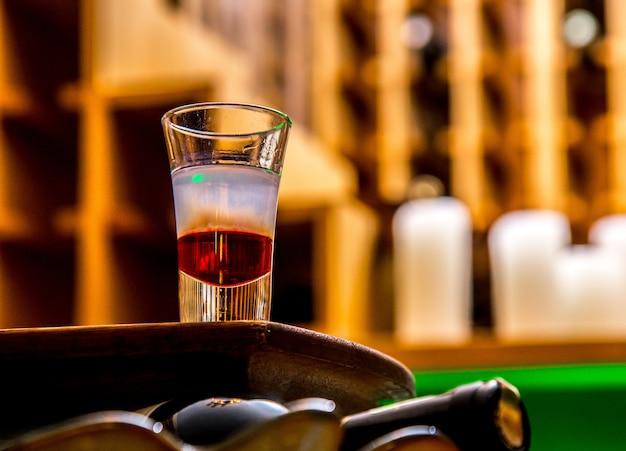 Alkohol erschossen auf tisch sude ansicht Kostenlose Fotos