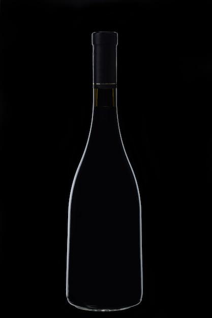 Alkoholisches getränk in einer glasflasche im dunkeln Kostenlose Fotos