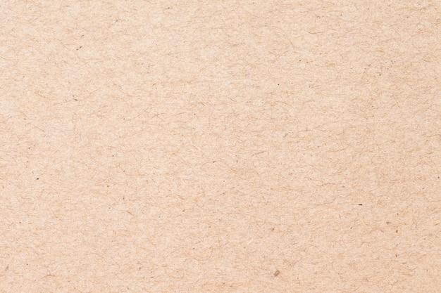 Alt von der braunen kraftpapierkastenbeschaffenheit für hintergrund Premium Fotos