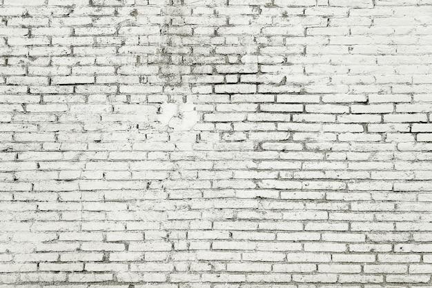 Alte backsteinmauer mit weißer farbenhintergrundbeschaffenheit Premium Fotos